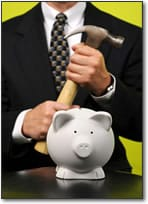 businessman with hammer in front of piggy bank © Gino Santa Maria