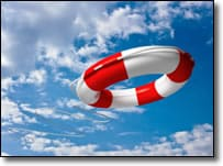 Life preserver against a blue sky with white clouds
